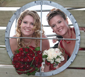 Bride and bridesmaid framed by port hole